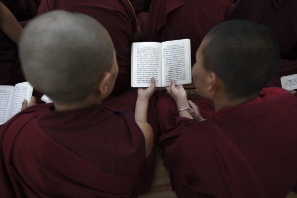 Tibetan nuns pray at Buddha Park during a peaceful demonstration in Kathmandu March 23, 2008. China accused the Dalai Lama on Sunday of using unrest in Tibet to back demands for Tibetan independence ahead of the August Olympic Games in Beijing