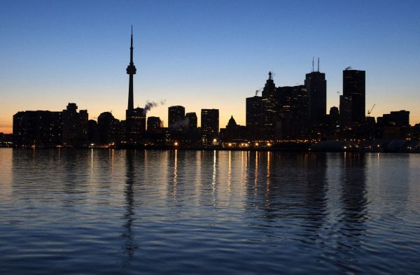 The Toronto city skyline, normally aglow with lights from office buildings, is seen dark during Earth Hour in Toronto, March 29, 2008