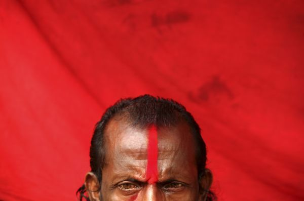 A Sadhu, an Indian Hindu holy man, waits inside a makeshift tent on the banks of the river Ganges in the eastern Indian city of Kolkata January 11, 2009