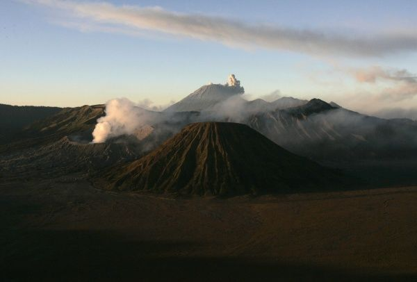 Smoke rises from Mount Semeru (back, centre) as seen from Pananjakan in the district of Pasuruan in East Java province in this September 16, 2008 file photo. Indonesia has raised to maximum its alert on the Mount Semeru volcano in East Java