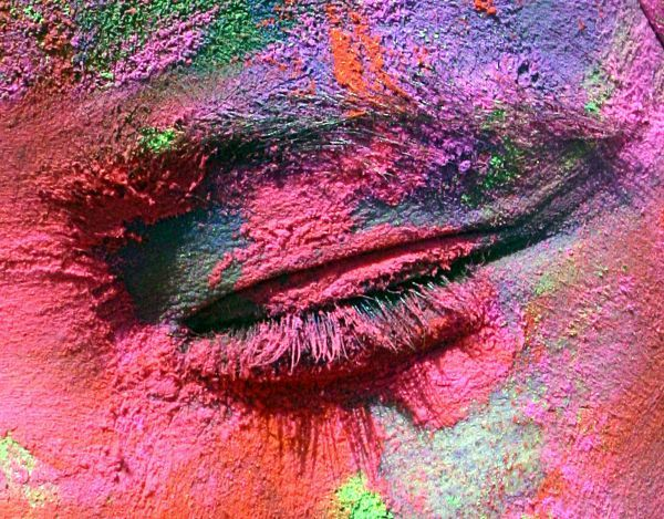 A student, smeared in colours, is seen during the celebrations of the Holi, the Indian festival of colours, in the northern Indian city of Chandigarh March 10, 2009. The tradition of Holi heralds the beginning of spring and is celebrated all over India