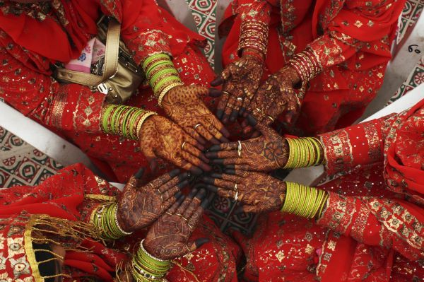 Muslim brides display hands painted with henna during a mass wedding ceremony in the western Indian city of Ahmedabad April 5, 2009