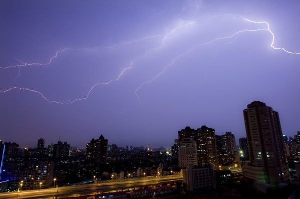 Flashes of lighting illuminate the sky during a thunderstorm over Shanghai July 12, 2009. REUTERS/Aly Song (CHINA ENVIRONMENT IMAGES OF THE DAY)