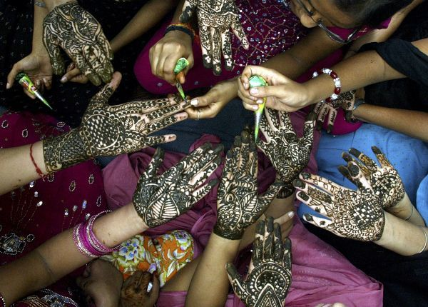 Women show their hands decorated with henna paste during the 'Teej' festival in the northern Indian city of Amritsar July 25, 2009