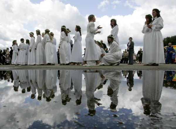Girls receive instructions as they wait to attend a procession during the celebration of Assumption of the Virgin Mary in Aglona, about 250 km (155 miles) from Riga, August 15, 2009