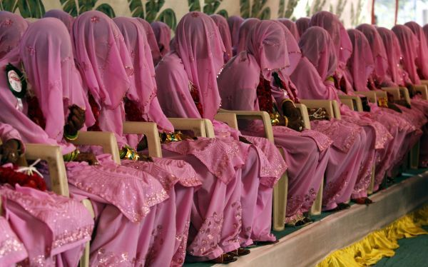 Muslim brides wait for their wedding ceremonies to start during a mass marriage ceremony in the western Indian city of Ahmedabad November 8, 2009