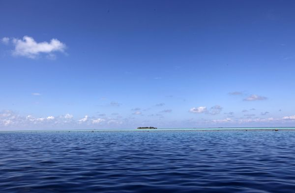 Clouds move over a resort island at the Male Atoll December 8, 2009
