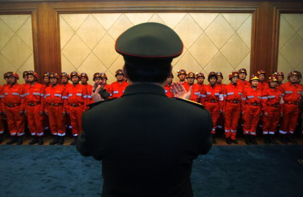 A senior military officer of the Chinese People's Liberation Army speaks to members of China International Search and Rescue Team during a departure ceremony at Beijing airport January 13, 2010