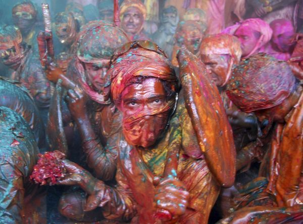 "Men daubed in colours celebrate the re-enactment of a local tradition of ""Lathmar Holi'"", also known as the festival of colours, celebrated at Barsana in the northern Indian state of Uttar Pradesh February 23, 2010"