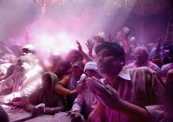 Hindu devotees celebrate Holi, also known as the festival of colours, at a temple on the outskirts of the northern Indian city of Mathura February 28, 2010