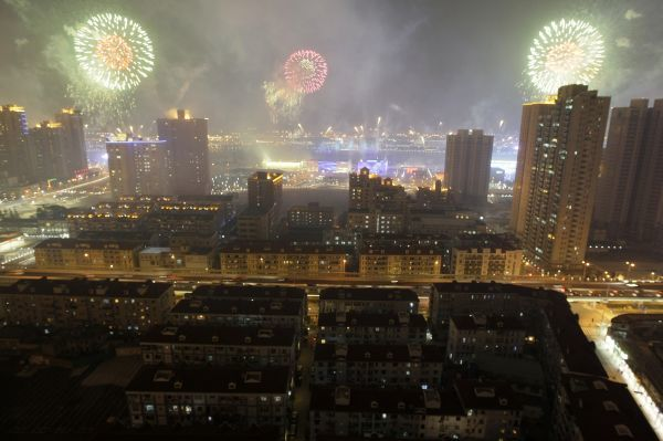 Fireworks explode over the Shanghai World Expo site during a rehearsal its opening ceremony April 27, 2010