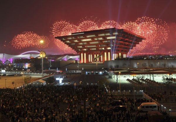 Fireworks explode above the China Pavilion as thousands of local residents watch during the opening ceremony of the Shanghai World Expo in Shanghai April 30, 2010