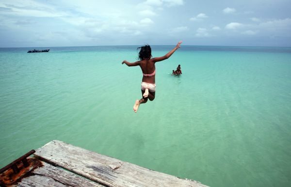 A girl jumps into the sea in The Corn Islands June 16,2010. REUTERS/Oswaldo Rivas (NICARAGUA - Tags: SOCIETY TRAVEL IMAGES OF THE DAY)