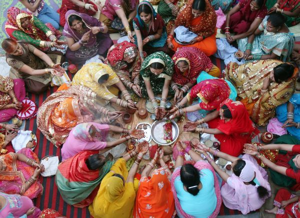 Women pray during the Hindu festival of Karva Chauth inside a temple in the northern Indian city of Chandigarh October 26, 2010. Married Hindu women observe a one-day fast and offer prayers for the well-being of their husbands during the festival