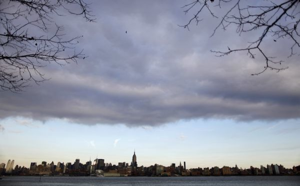 A low level cloud formation hovers over New York's Empire State Building and the skyline of midtown Manhattan as seen across the Hudson River in Hoboken, New Jersey, November 21, 2010