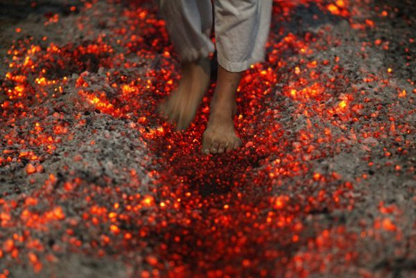 A Shi'ite Muslim walks on fire at a ceremony during the Ashura festival at a mosque in central Yangon December 16, 2010