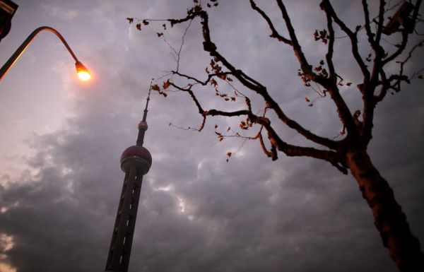 The Oriental Pearl TV tower is seen during sunset at the financial district of Shanghai December 19, 2010. REUTERS/Carlos Barria (CHINA - Tags: MEDIA SOCIETY)