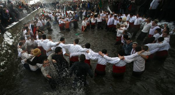 Bulgarian men dance in the icy waters of the Tundzha river during a celebration for Epiphany Day in the town of Kalofer, some 150 km (93 miles) east of Sofia January 6, 2011. It is believed that the ritual will bring health throughout the new year