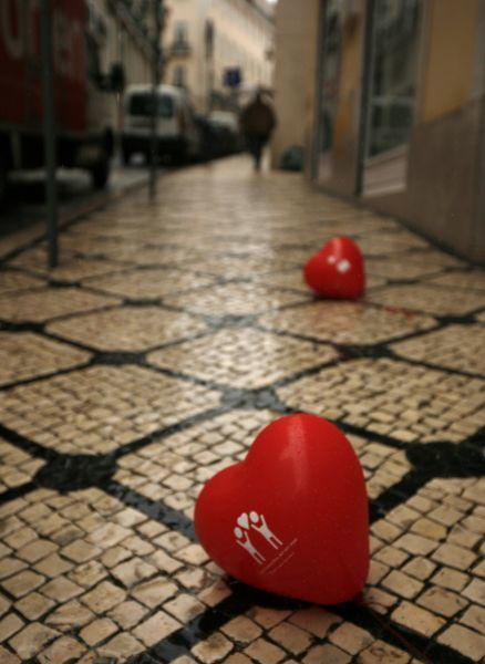 Valentine's Day balloons lie on the street in Lisbon February 14, 2011. REUTERS/Rafael Marchante (PORTUGAL - Tags: SOCIETY)