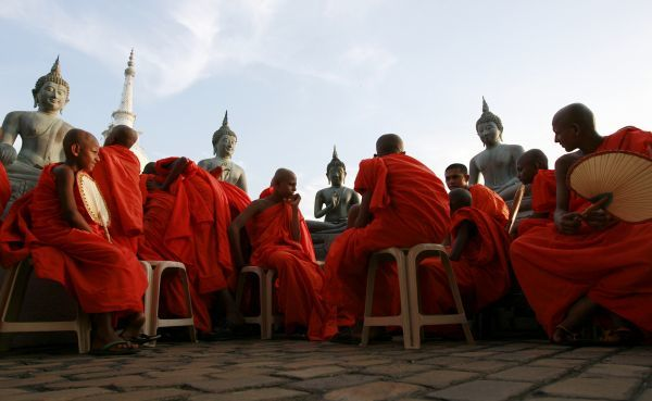 Buddhist monks wait at a temple for the start of the first of two days of the Navam Perahera, a Buddhist pageant of elephants, dancers and drummers, in Colombo February 16, 2011. The event is held to celebrate Poya day or full moon day in February