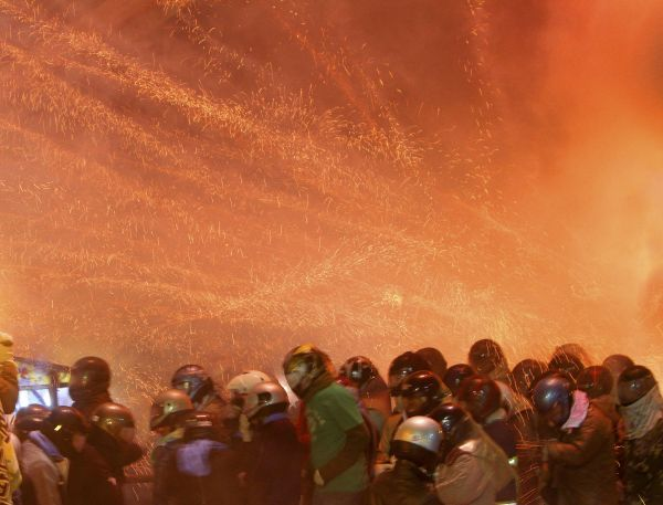 "People get hit by firecrackers during the Yanshui Beehive Rockets Festival, as part of the Chinese Lantern Festival or ""Yuan Xiao Jie"", in Tainan County February 16, 2011"