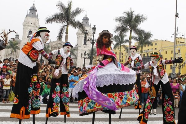 Artists perform in front of the city's cathedral during the week of World Theatre Day in Lima's Plaza Mayor March 25, 2012. World Theatre Day falls on March 27 and the City Hall has organized a week-long program that features theatre performances