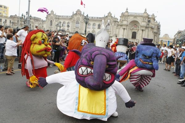 Artists dressed as midget monsters perform in celebrations during the week of World Theatre Day in Lima's Plaza Mayor March 25, 2012