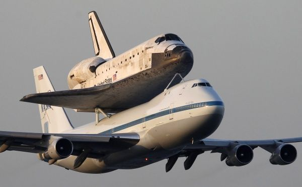 The space shuttle Discovery, attached to a modified NASA 747 aircraft, makes a final flyby before heading for it's final home at The Smithsonian National Air and Space Museum Steven F
