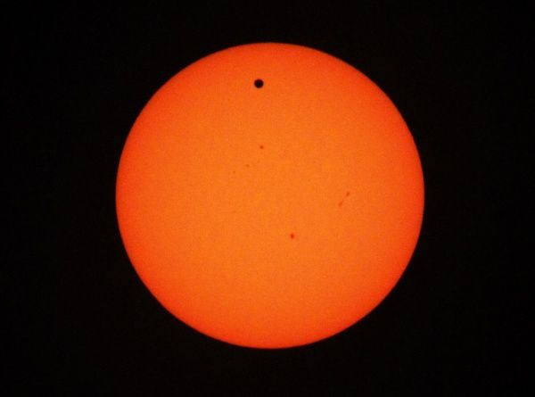 The planet Venus makes its transit across the Sun as seen from Beirut June 6, 2012. Venus made a slow transit across the face of the sun on Tuesday, the last such passing that will be visible from Earth for 105 years. REUTERS/Jamal Saidi (LEBANON - Tags