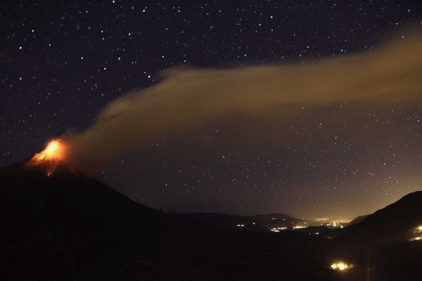 Ecuador's Tungurahua volcano spews a large cloud of ash to the nearby town of Bilbao, August 21, 2012. The authorities are encouraging residents living near the volcano to evacuate due to increased activity of the volcano, according to local media