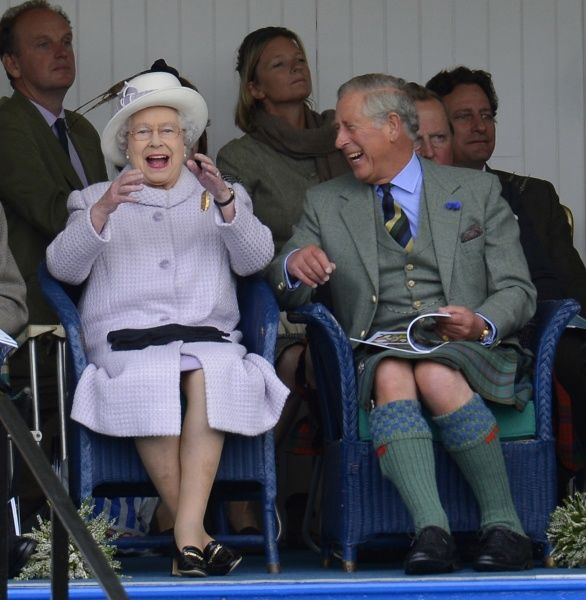 Members of Britain's royal family (front L-R) Queen Elizabeth and Prince Charles cheer as competitors participate in a sack race at the Braemar Gathering in Braemar, Scotland September 1, 2012