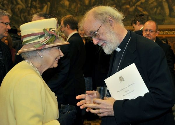 Britain's Queen Elizabeth speaks with Rowan Williams, The Archbishop of Canterbury during a reception at the Houses of Parliament in London March 20, 2012. REUTERS/Toby Melville (BRITAIN - Tags: ROYALS POLITICS RELIGION SOCIETY ENTERTAINMENT)