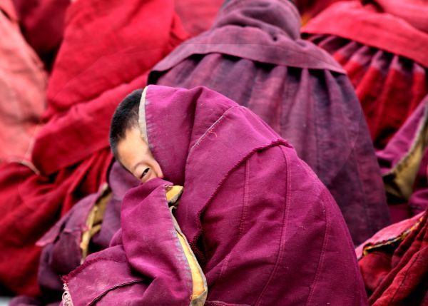 Ethnic Tibetan monks attend prayers at the Labrang Monastery in Xiahe, western China's Gansu province, February 9, 2006
