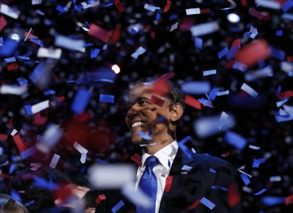 U.S. President Barack Obama celebrates on stage as confetti falls after his victory speech during his election rally in Chicago, November 6, 2012. REUTERS/Kevin Lamarque (UNITED STATES - Tags: POLITICS ELECTIONS USA PRESIDENTIAL ELECTION)
