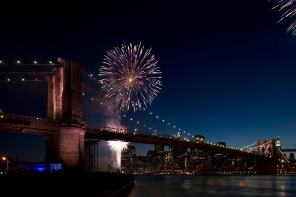Fireworks can be seen behind the Brooklyn Bridge during its 125th anniversary celebrations in New York May 22, 2008. This year marks the 125th anniversary of the bridge being built over the East River linking Manhattan to Brooklyn. REUTERS/Carey Horowitz