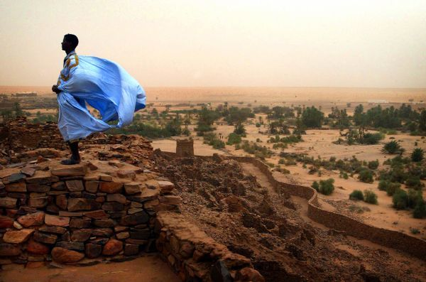 File photo shows a Mauritanian man's clothing blown by wind in the ancient village of Ouadane, some 600 kilometers (400 miles) northeast of the capital Nouakchott, August 16, 2005. The Islamic Republic on the western edge of the Sahara desert on June 25