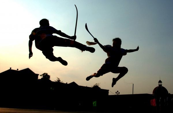 Students practise sword-fighting at a kung fu school in Hefei, east China's Anhui province August 9, 2006. About 2000 young students aged from 5 to 16 gather there to learn martial arts, local media reported. Picture taken August 9, 2006