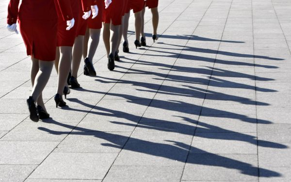 Hostesses for China's Communist Party 17th Congress walk in line on Tiananmen Square during a preparatory meeting in Beijing October 14, 2007. China's Communist Party opens its 17th Congress on October 15. REUTERS/Jason Lee (CHINA)
