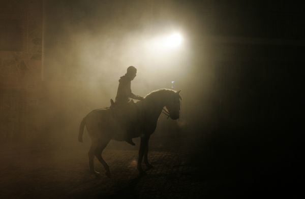 "A man rides his horse during the ""Luminarias"" annual religious celebration on the night before Saint Anthony's, Patron of animals, in the village of San Bartolome de los Pinares, about 100 km (62 miles) north west of Madrid, January 16, 2008"
