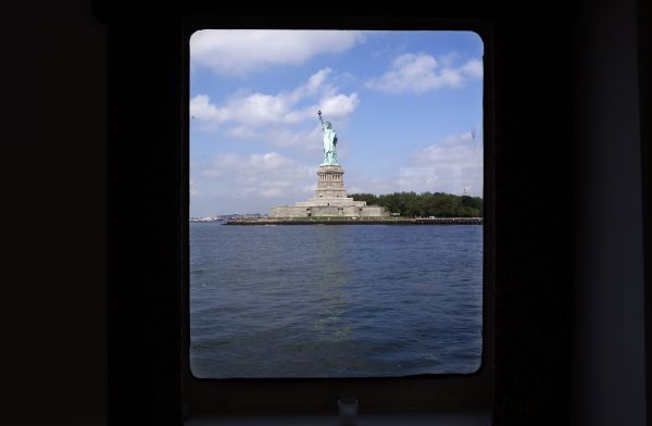 The Statue of Liberty is through a cabin window in this photograph taken from a tour boat in New York Harbor, June 30, 2008. REUTERS/Mike Segar (UNITED STATES)