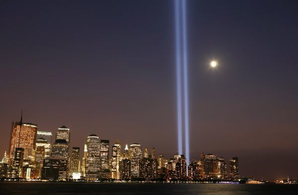 "The moon rises over lower Manhattan as the ""Tribute in Lights"" illuminates the sky on the seventh anniversary of the attack on the World Trade Center in New York September 11, 2008"