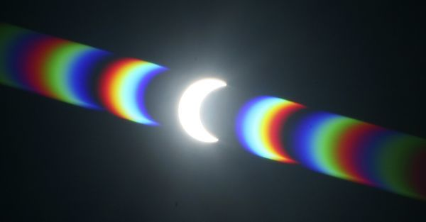 Light is diffracted on a filter during a partial solar eclipse, where the moon moves between the sun and earth, as seen from Cape Town, January 26, 2009. Picture taken using exposed x-ray film as a filter. REUTERS/Mike Hutchings (SOUTH AFRICA)
