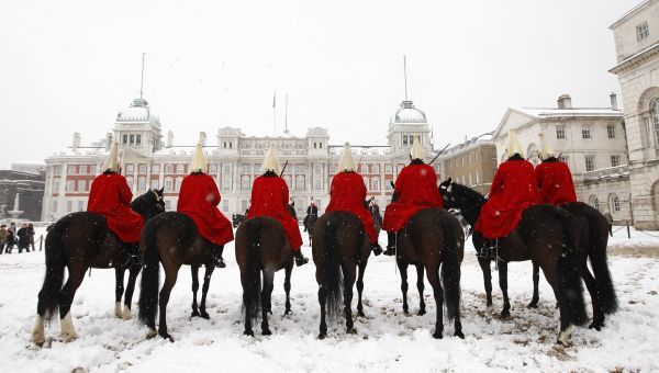 Members of the Household Cavalry Mounted Regiment wait for the changing of the guard at Horse Guards Parade in a snow storm in London February 2, 2009. Heavy snow brought much of London's transport to a halt on Monday with airport runways forced to close