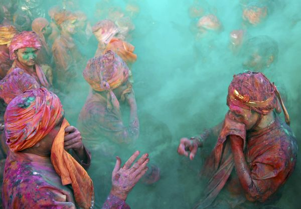People throw coloured powder while celebrating the Hindu festival of Holi (festival of colours) at Nand Gaon in the northern Indian state of Uttar Pradesh, March 6, 2009. The tradition of Holi heralds the beginning of spring and is celebrated all over India