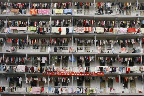 Laundry hangs outside a student dormitory at a college in Wuhan, Hubei province in this March 5, 2009 file photo. Down-at-heel Xiaojiahe in Beijing's university district seems an unlikely haven for China's aspiring elite, but its reeking alleys
