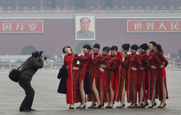 Hostesses pose for pictures on Tiananmen Square during the closing ceremony of the Chinese People's Political Consultative Conference (CPPCC) in Beijing March 12, 2009. REUTERS/Reinhard Krause (CHINA POLITICS IMAGE OF THE DAY TOP PICTURE)