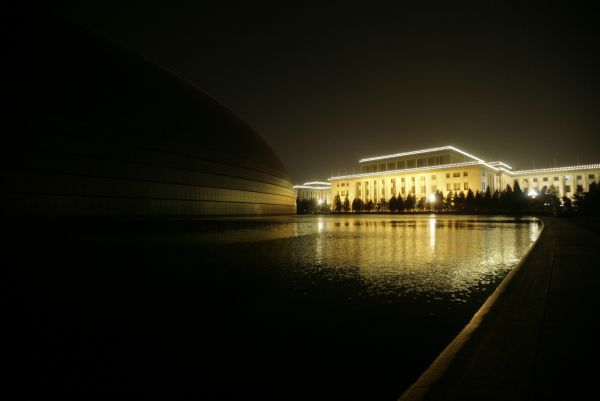 Beijing's National Grand Theater (L) is pictured next to the Great Hall of the People during Earth Hour March 28, 2009