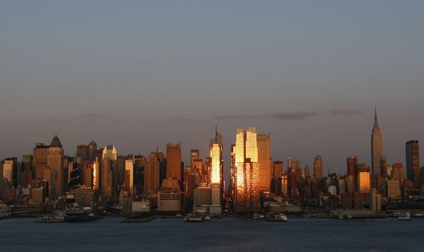 "The setting sun reflects off the buildings of Manhattan at sunset during the biannual occurrence named ""Manhattanhenge"" in New York May 31, 2009"
