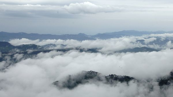 A partial belt of the runway of the Jubbarhatti airport is seen amid monsoon clouds in the northern Indian hill town of Shimla July 29, 2009