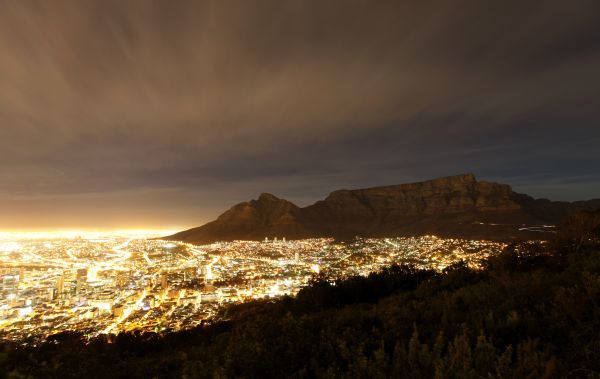 Cape Town lights up as dusk falls over the city's backdrop Table Mountain, November 2, 2009